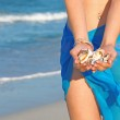 Woman on beach on summer vacation collecting shells — Stock Photo #6555100