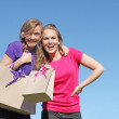 Girl teenagers shopping with bag from recycled paper — Stock Photo