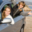 Mother and son in new hire or rented car on vacation — Stock Photo