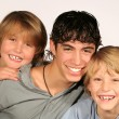 Stock fotografie: Happy group of smiling, brothers with white teeth
