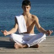 Meditation or yoga, man meditating outdoors - Stock Photo