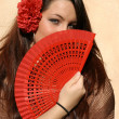 Spain, spanish woman with fan - Stock Photo