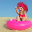 Happy kid on vacations on beach pointing — Stockfoto