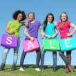 Group of girls shopping in sales with bags — Stok fotoğraf