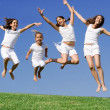Happy kids jumping outdoors in summer — Stock Photo