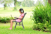 Young girl sitting and listening to music — Stock Photo