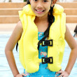 Girl are smiling and a standing in a pool — Stock Photo #6302174