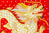 Red silk embroidered dragon art, Myanmar — Stock Photo