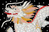 Black silk embroidered dragon art, Myanmar — Stock Photo