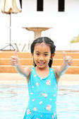 Very happy young girl in the swimming pool — Stock Photo