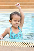 Girl are smiling and practice swimming — Stock Photo