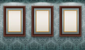 Wooden frames on the wall. — Stock Vector