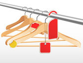 Wooden hangers with sale tags and stickers — Stock Vector