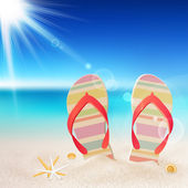 Flip-flops and shells on the beach — Stock Vector