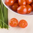 Cherry tomatoes and chives — Stock Photo