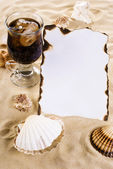 Burned paper with shells and drink — Foto de Stock