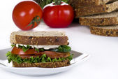 Bacon and vegetable sandwich — Stock Photo