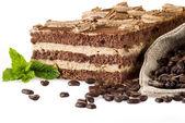 Tiramisu cake with bag of coffe — Stock Photo