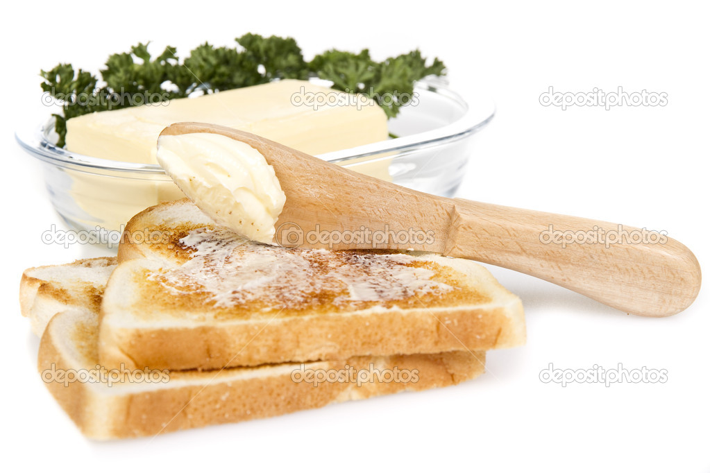 Toasts with butter and knife over white background — Stock Photo #6519244