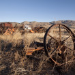 Old farm equipment in a field — Stock Photo