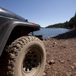 Stock Photo: 4x4 offroad adventure by lake in sierras
