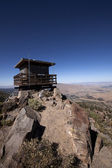 Lookout tower in a mountain range — Stock Photo