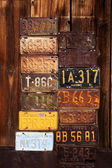 Vintage License Plates with a wood background — Stock Photo