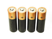 Four batteries on a white background — Stock Photo