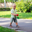 Stock Photo: Little boy walks in park