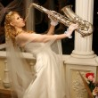 Bride plays the saxophone — Stock Photo