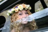 Bride sits in the car — Stock Photo