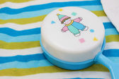 Baby cloth with baby toy — Stock Photo