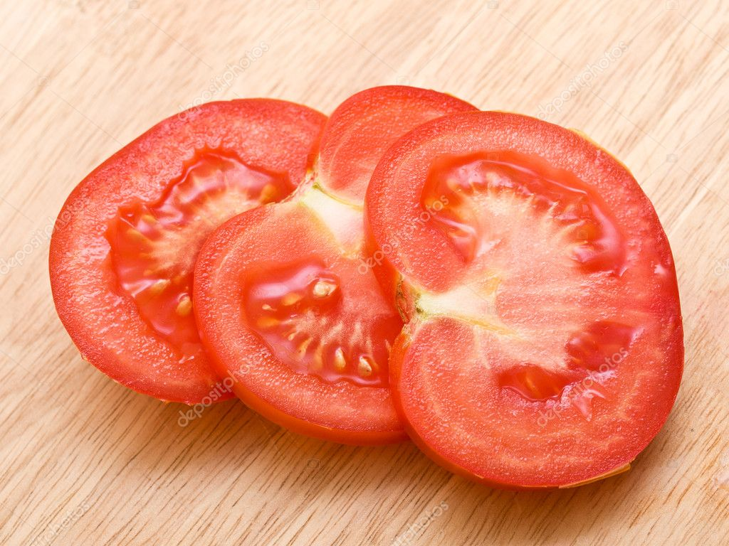 Red tomato slices on chopping board   Stock Photo #5860704