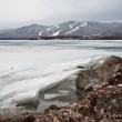 Ice on the coast of lake — Stock Photo