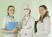 Three lady doctors staying indoors — Stock Photo