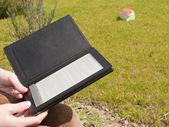 Ebook reader held by hands — Stock Photo