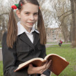 Stock Photo: Teen girl with book in park