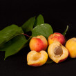 Stock Photo: Ripe apricots on black background