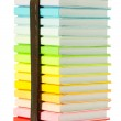 Stack of colorful books on the white background — Stock Photo #6057635
