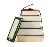 Stack of books and electronic book reader on the white background — Fotografia Stock