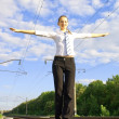 Young lady balancing on the rail road track — Stock Photo