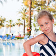 Beautiful girl at the swimming pool — Stock Photo