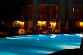 Hotel and resort swimming pool at night — Stock Photo