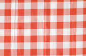 Background from a natural fabric in a red and white cell — Stock Photo