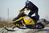 Flying of ski mobile rider — Stock Photo