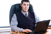 Portrait of a young businessman with laptop — Stock Photo