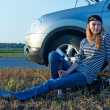 Young Blond Woman With Her Broken Car - Photo