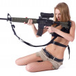 Pretty woman with rifle — Stock Photo