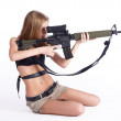 Pretty woman with rifle — Stock Photo #5574821
