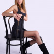 Pretty woman on old chair — Stock Photo